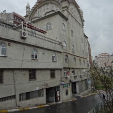 Mixing uses is normal in Istanbul. This is a mosque with at least two different companies operating at street level.