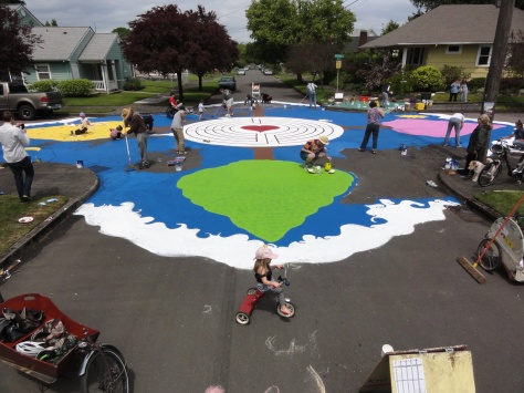 Intersection repair is one form of Tactical Urbanism. The goal is to slow down traffic and upgrade public space. Image source: Flickr.