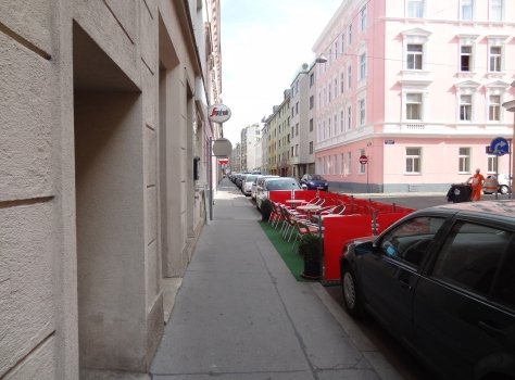 I ran into several applications of the parklet concept in Vienna. Parklets are a popular form of Tactical Urbanism and the idea has spread around the world. I don't know the exact story behind Vienna's parklets.